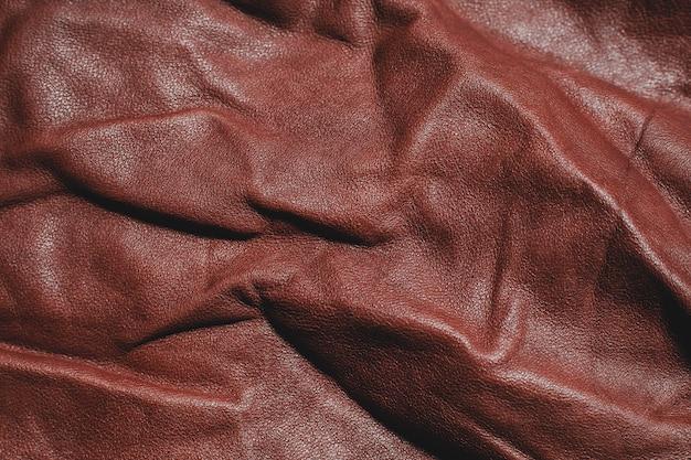 Trama di pelle marrone naturale. modello vuoto astratto.