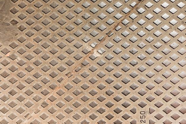 Trama di piastra metallica