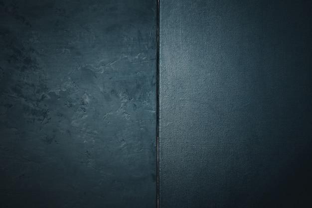 Trama di pietra o roccia ruvida e trama tela colore nero. elegante con vintage in difficoltà grunge e sfondo grigio scuro.