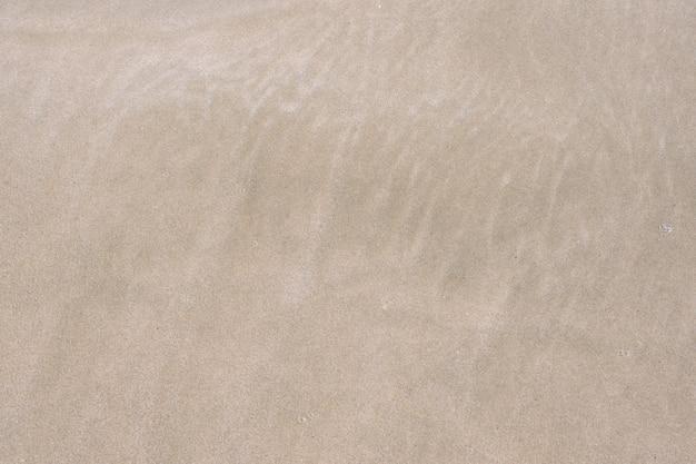 Trama di sabbia spiaggia sabbiosa per lo sfondo