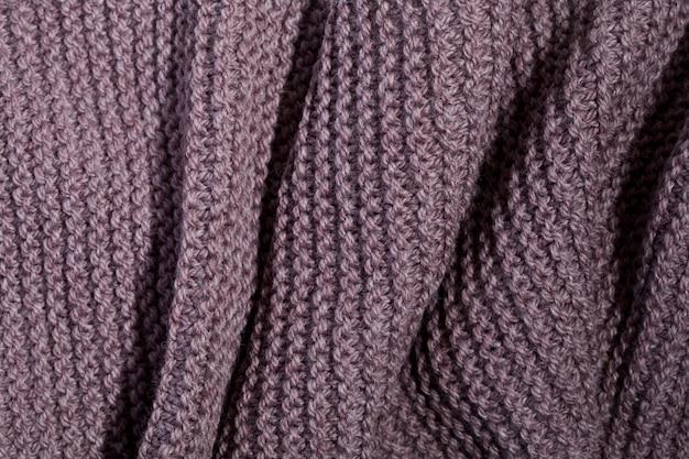 Trama di sciarpa marrone a maglia.
