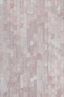 Trama di sfondo della vecchia parete di marmo beige da una varietà di grandi piastrelle