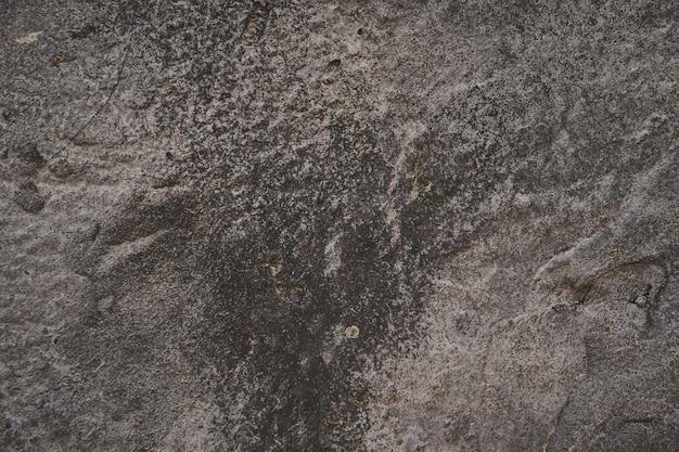 Trama di sfondo di asfalto. vecchia parete verniciata dura nello stile del grunge. vista da vicino grigio