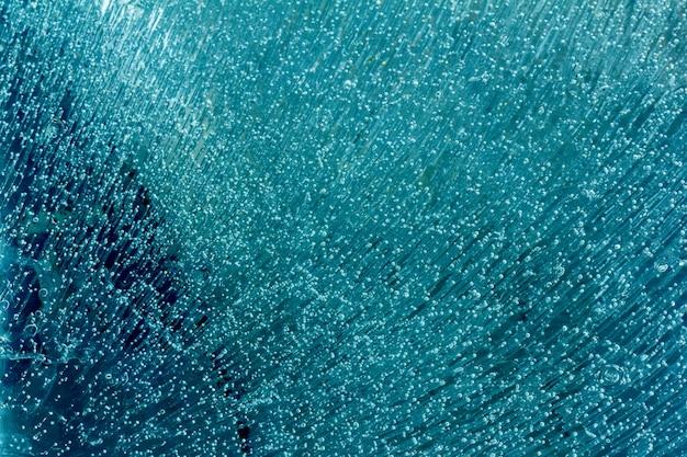 Trama di sfondo di ghiaccio con bolle d'aria congelate