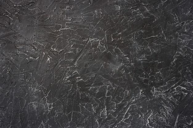 Trama di sfondo di stucco nero con venature bianche,