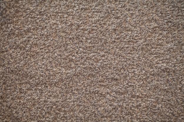 Trama di sfondo grigio spugna di cotone naturale asciugamano