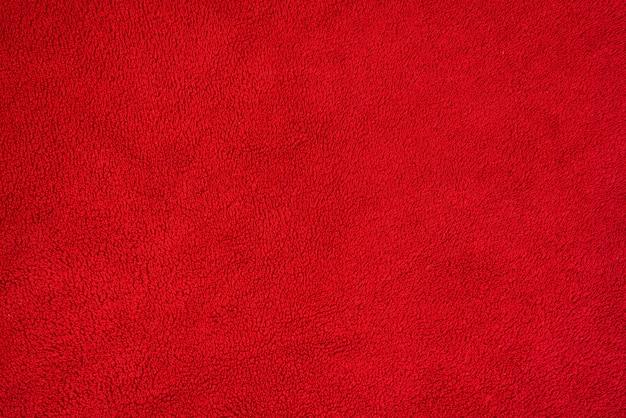 Trama di sfondo liscio di un asciugamano di spugna. colore rosso