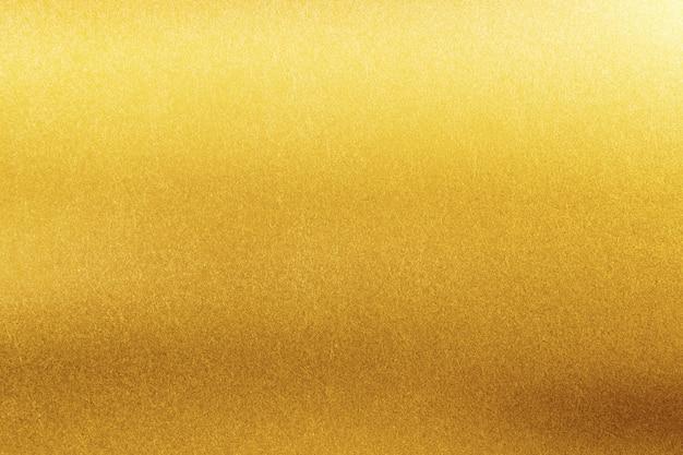 Trama di sfondo oro. retro superficie della parete lucida dorata.