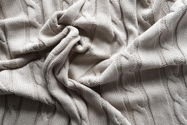 Trama di tessuto a maglia grigia con un motivo