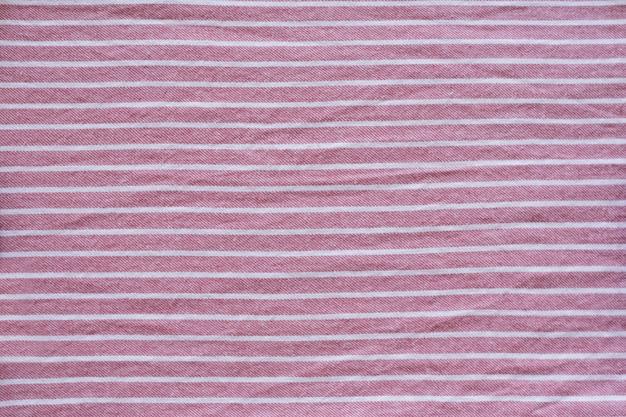 Trama di tessuto a strisce sullo sfondo. avvicinamento. concetto di moda
