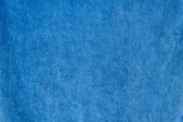Trama di tessuto di sfondo denim liscio. colore blu scuro