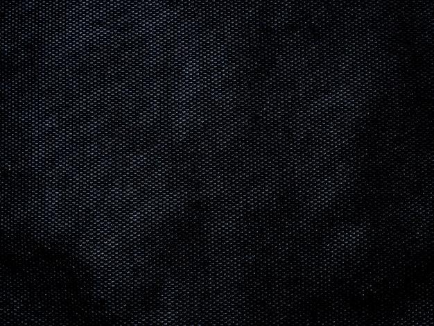 Trama di tessuto nero astratto sfondo ruvido con spazio vuoto per il design.
