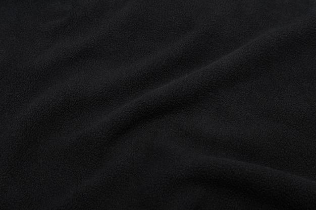 Trama di tessuto nero, sfondo modello panno.