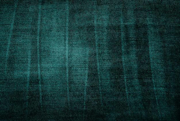 Trama di tessuto verde vintage logoro
