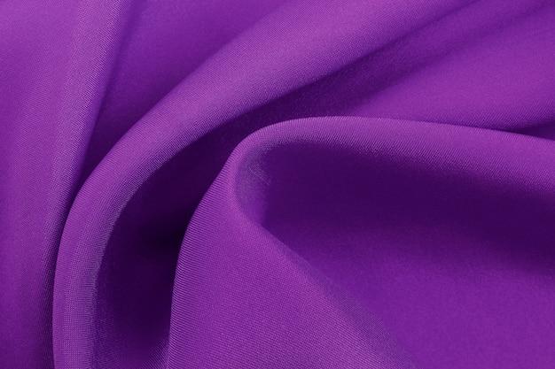 Trama di tessuto viola per sfondo e design, bellissimo motivo di seta o lino.