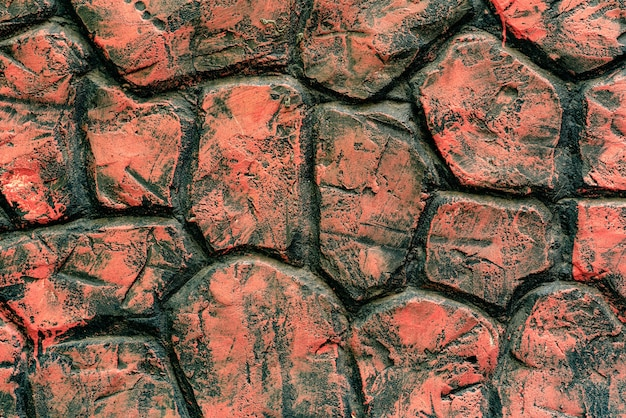 Trama di un muro di mattoni con crepe e graffi sullo sfondo