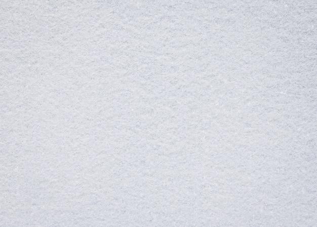 Trama feltro bianco. sfondo di tessuto bianco. dettaglio del materiale del tappeto.