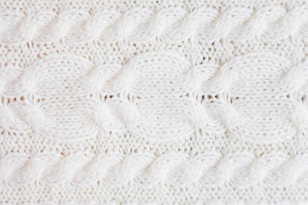 Trama maglione di lana bianca.