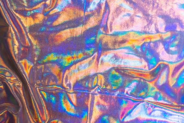 Trama olografica iridescente a lamina di sirena. colori d'argento alla moda futuristici al neon