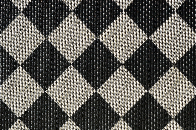 Trama plastica a forma di rilegatura in tela molto piccola, dipinta in nero e grigio