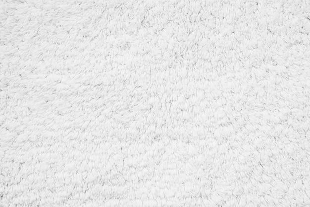 Trame e superficie del tappeto in cotone bianco