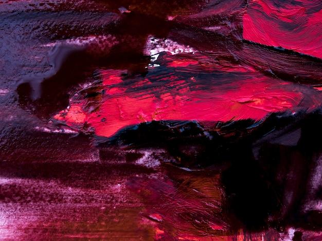 Tratti di pennello disordinati rosa e neri su tela