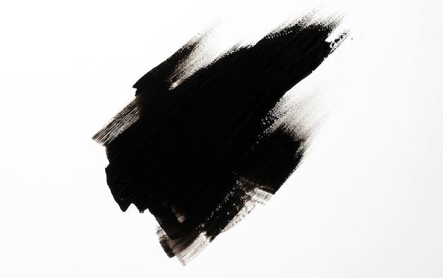 Tratto di pennello nero su sfondo bianco