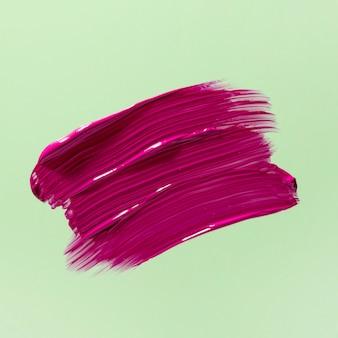 Tratto di pennello rosa con sfondo verde