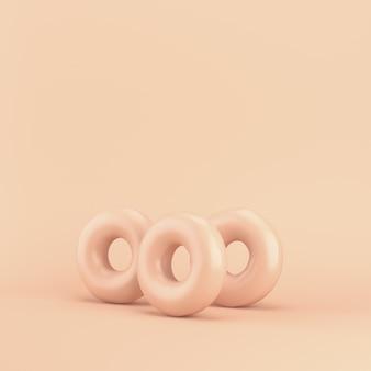 Tre ciambelle su pastello rosa con copia spazio. rendering 3d