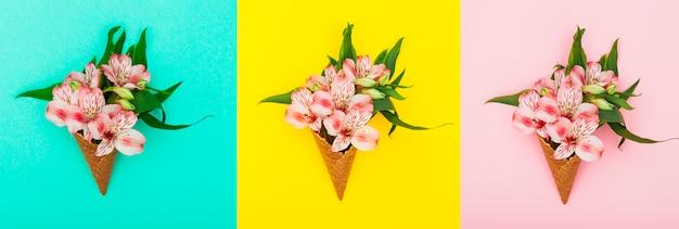 Tre coni waffle con fiori sul tavolo