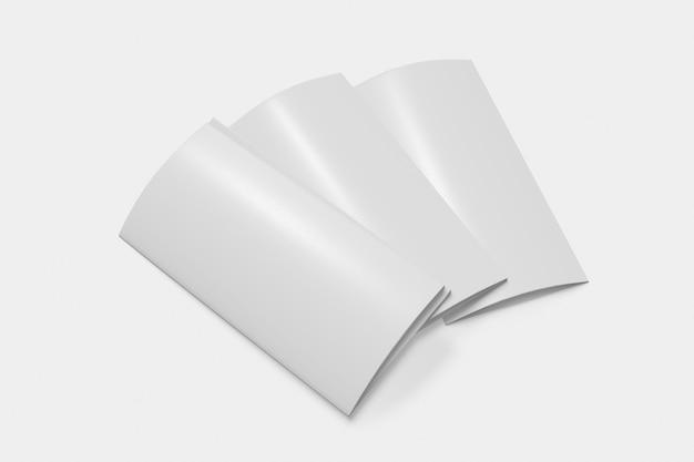 Tre libretti pieghevoli chiusi su sfondo bianco