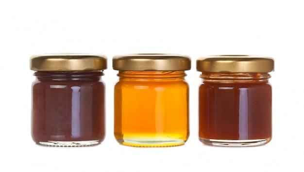 Tre vasetti di marmellata e miele