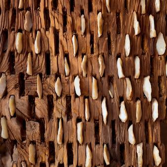 Trebbiatura di legno invecchiato e pietre tessitura