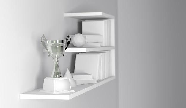 Trofeo del campione disposto sulla mensola di libro interna vuota bianca.