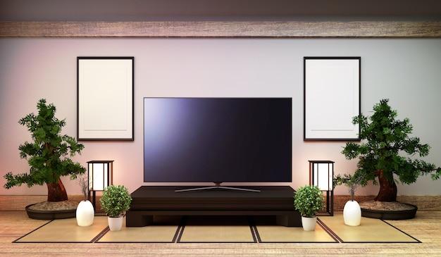 Tv giappone - smart tv sul tavolino in stile giapponese con lampada e bonsai.