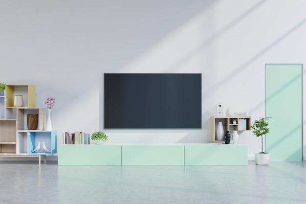 Tv sul mobile verde nel moderno salotto con piante in soggiorno con parete bianca vuota.