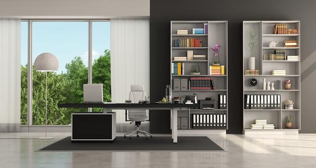 Ufficio moderno in bianco e nero con desktop e libreria - rendering 3d