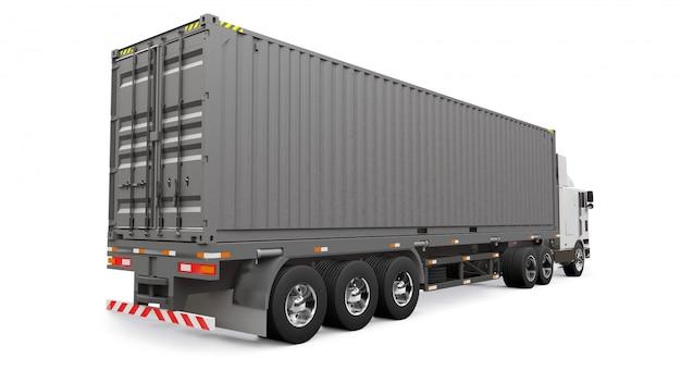Un grande camion bianco retrò con una parte per dormire e un'estensione aerodinamica trasporta un rimorchio con un container marittimo