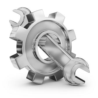 Un ingranaggio di metallo e una chiave inglese.