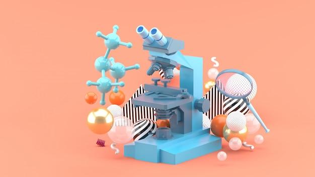 Un microscopio blu tra palline colorate su rosa. rendering 3d.