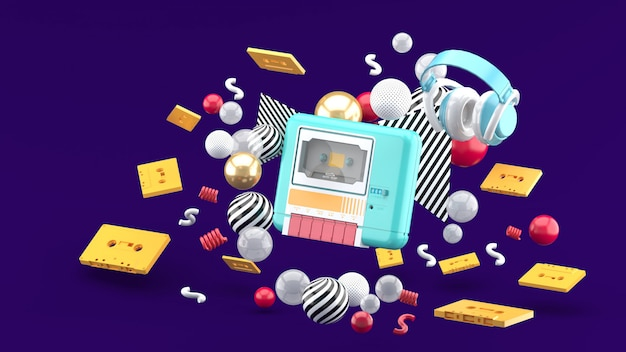 Un riproduttore di cassette blu circondato da nastri e palline colorate su viola. rendering 3d.