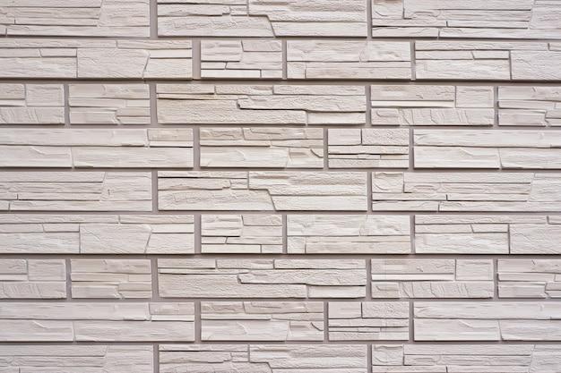 Un rivestimento artificiale in pietra decorativa. guarda direttamente
