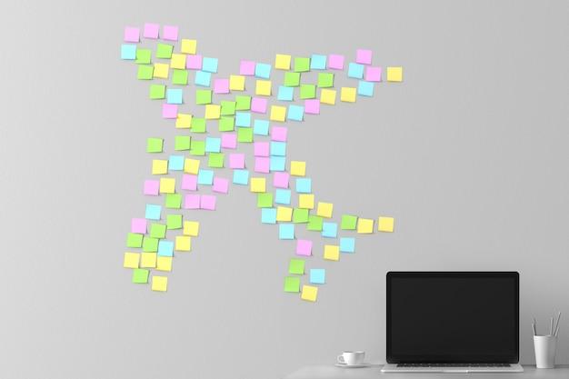 Un sacco di adesivi incollati sul muro grigio accanto al portatile. concept art sul tema del viaggio e del tempo libero