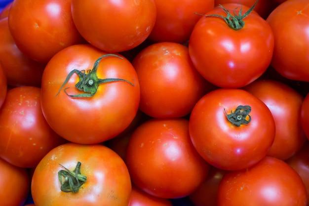Un sacco di sfondo rosso pomodori