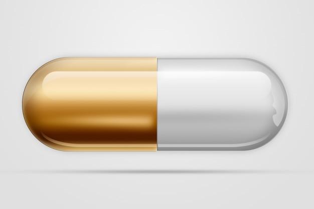 Una compressa sotto forma di capsule di colore oro,