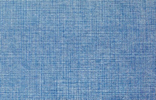 Una copertina del libro di stoffa vintage con uno sfondo blu