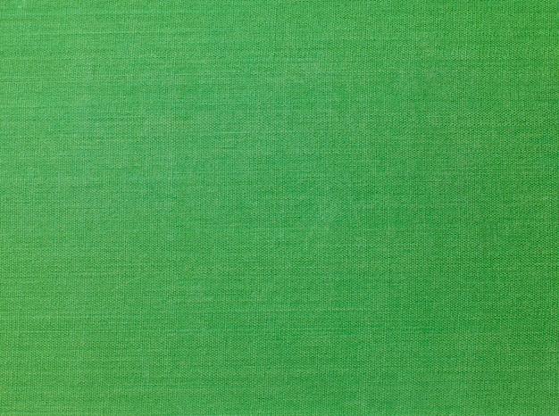 Una copertina del libro di stoffa vintage con uno sfondo verde