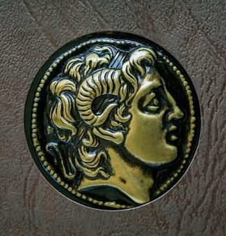 Una copia della moneta greca antica