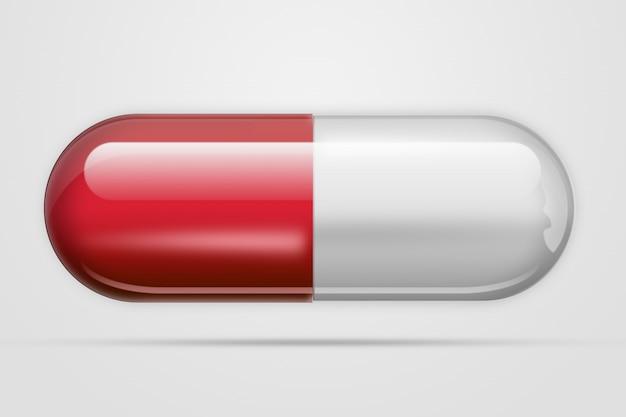 Una pillola in formcapsule di colore rosso, una luce