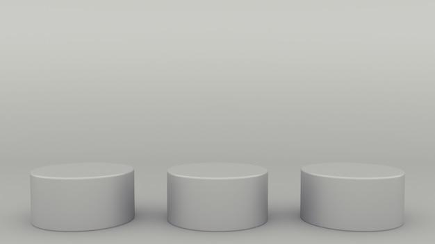 Una scena grigia 3d di tre podi cilindrici che rende minimalista moderno
